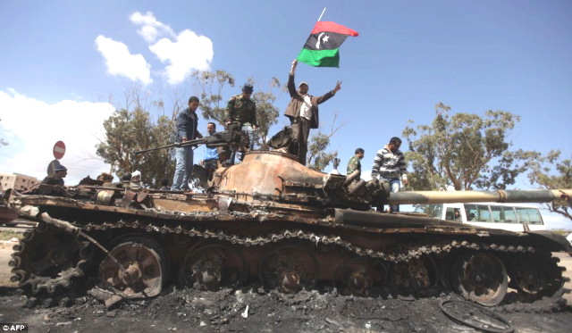 Britain, the Traitor Nation: Media Disinformation and Crimes against Humanity in Libya  Libya war Burnt tank