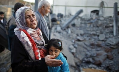 A Palestinian woman cries next to a relative's house after it was destroyed in what witnesses said was an Israeli air strike in Beit Lahiya in the northern Gaza Strip