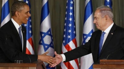 U.S. President Obama and Israel's Prime Minister Netanyahu shake hands at a joint news conference at the Prime Minister's residence in Jerusalem