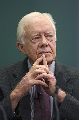 Former U.S. President and Nobel Laureate Jimmy Carter gestures at the 21st Hay Festival