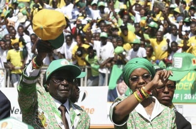 Zimbabwe President Robert Mugabe and his wife Grace arrive to address the final campaign rally of his ZANU-PF party in Harare