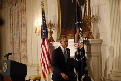 President Barack Obama addresses the nation regarding an agreement reached with Iran that would temporarily freeze Tehran's nuclear program .