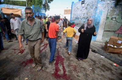 Blood on the ground at a United Nations run school after Israeli air strikes in Rafah in the southern Gaza Strip