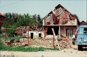Damaged home adjacent to destroyed neighborhood on Vuk Karadzhich Street. Yugoslavia Photo: Gregory Elich