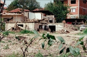 Caption: Damaged home near bombed neighborhood of Nishka and Uzhichka Streets. Photo: Gregory Elich