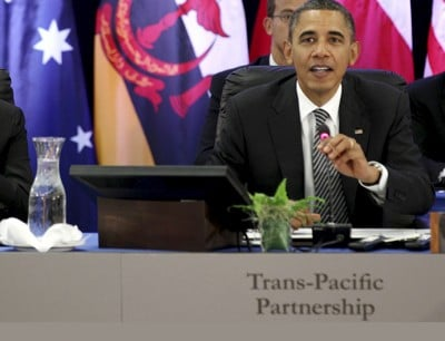 Obama speaks as Hassanal Bolkiah listens during the Trans-Pacific Partnership Leaders meeting at the Hale Koa Hotel during the APEC Summit in Honolulu