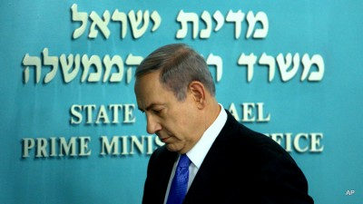 Israeli Prime Minister Benjamin Netanyahu walks out following a press conference at his Jerusalem office on Tuesday, July 14, 2015. The nuclear deal with Iran could strike a heavy personal blow to Netanyahu, leaving him at odds with the international community and with few options for scuttling an agreement he has spent years trying to prevent. (AP Photo/Oren Ben Hakoon)