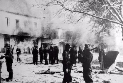 German troops in front of buildings set ablaze in Distomo, during the massacre.