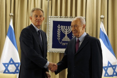 Israeli President Shimon Peres (R) shakes hand with Tony Blair, Special Envoy of the Quartet on the Middle East, at the start of their meeting to push for an end to the violence around Gaza, at the presidential compound in Jerusalem on November 19, 2012. AFP PHOTO/GALI TIBBON