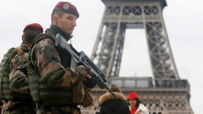 French soldiers at the Eiffel Tower after the Paris shootings. Photo: Reuters
