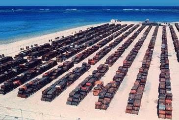A photo of some of the barrels of leftover Agent Orange. This storage dumpsite was only one of many, and it contained over a million gallons. Many of the barrels can be seen leaking into the sand of Johnston Island (near Hawaii). The island is not only heavily contaminated by Agent Orange, but also by highly radioactive plutonium from three nuclear disasters from plutonium bomb tipped THOR missiles, one of which exploded on the launch pad in the early 60s,permanently and lethally contaminating the island. The Agent Orange from these barrels were eventually incinerated at sea by a contract commercial vessel. The incineration process at times heavily contaminated its civilian crew as well as large portions of the Pacific Ocean. (Most of the radioactive hardware was either buried in the sand or dumped in the ocean.)