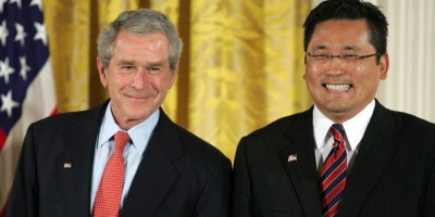 U.S. President George W. Bush with Kay Hiramine prior to presenting him with a President's Volunteer Service Award on May 10, 2007, in the East Room of the White House (photo flipped).