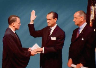 Richard Helms takes an oath at the his swearing in ceremony as Director of Intelligence. Photo credit: Adapted by WhoWhatWhy from (Jesse Wilinski / YouTube)