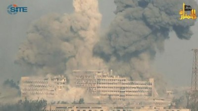 Al Kindi hospital (Aleppo) as it was being demolished by two truck bombs, December 2013. The operation was carried out by Jabhat al Nusra (see logo top right) and its FSA partners. Afterwards the Islamist-linked 'Physicians for Human Rights' tried to blame the Syrian Government for this destruction. Photo: Jabhat al Nusra