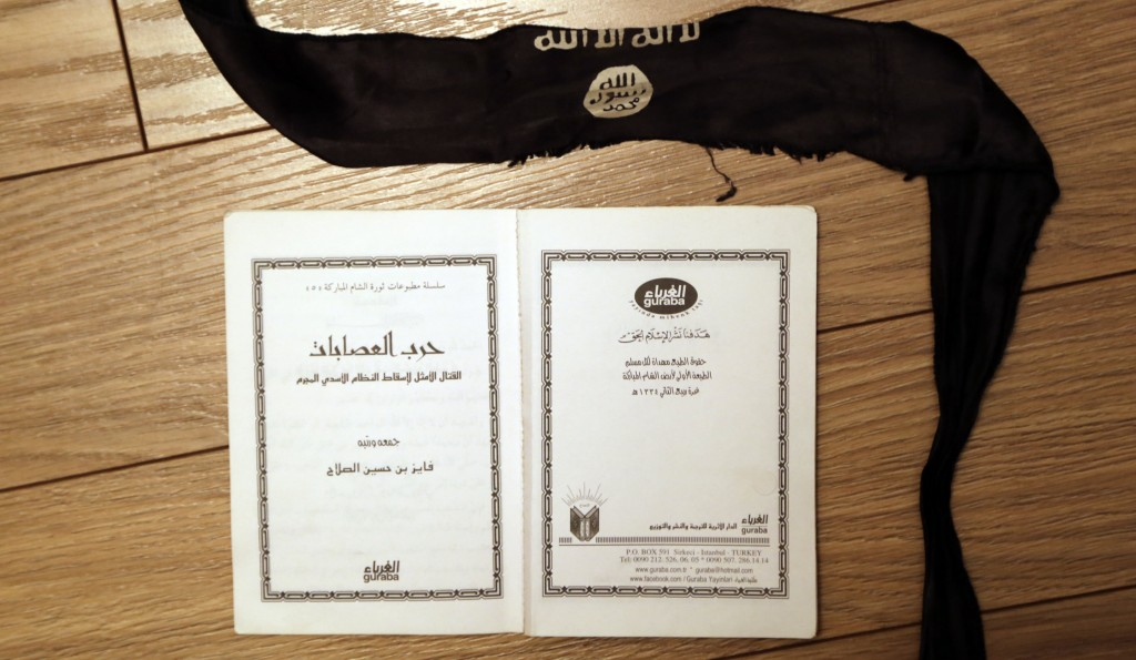 """A suicide bomber s head-band and a manual, entitled """"How to wage an ideal  fight against the criminal Assad regime"""" found in an office of one of the  Daesh ... f02ace0111c8"""