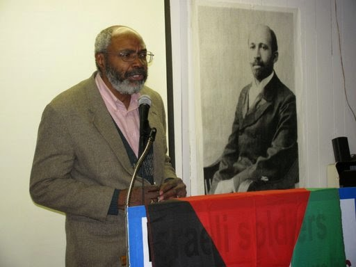 Abayomi Azikiwe with DuBois poster in background 2009
