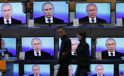 Russian President Vladimir Putin talks to the media after a live broadcast nationwide phone-in in Moscow