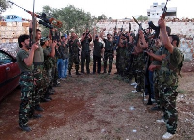 "Free Syrian Army members raise their weapons as they chant ""Allahu akbar"" during combat training at Sarmada near Idlib province"