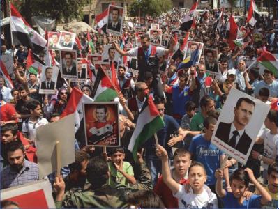 SANA-Syrians-pro-gov-rally-2014